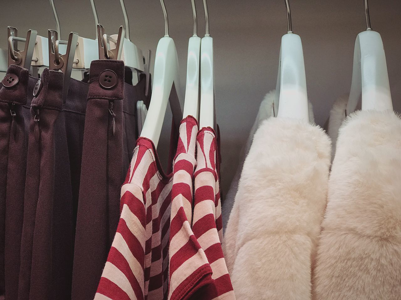 Hanging Clothing Cultures Coathanger No People Close-up Choice Day Clothes Stripes Pattern Jacket T-shirt Shop Boutique Store Collection Warm Large Group Of Objects Variation Choice Retail  Clothes Rack Clothing Store Hanging Fashion