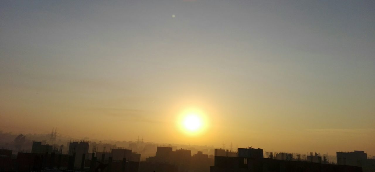sunset, cityscape, city, skyscraper, architecture, sun, building exterior, no people, modern, built structure, silhouette, sunlight, growth, downtown, sky, outdoors, urban skyline