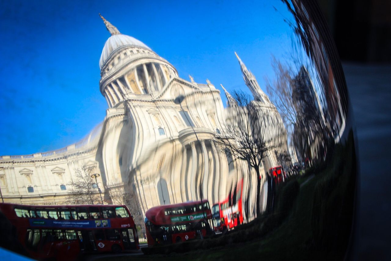 Architecture Low Angle View Building Exterior Sky City Built Structure Outdoors No People Day Architecturephotography Streetphotography Place Of Worship Cathedral Tourist Attraction  Convex Mirror Distortion Reflection London St Paul's Cathedral Everyday Travel Destinations Sculpture Transportation Londonbus