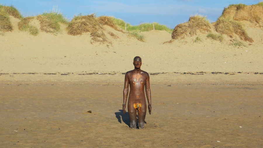 Statue Another Place By Anthony Gormley Beach Beauty In Nature Day Full Length Landscape Nature Outdoors People Sand Sand Dune Shirtless Sky Standing Vacations Water