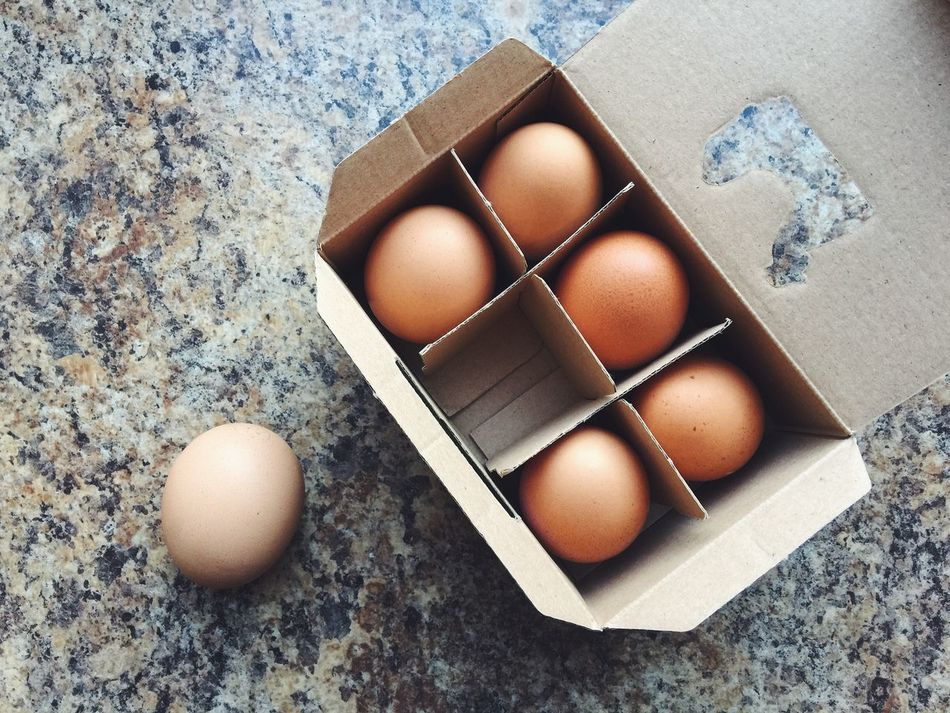 A box of six eggs Box Box - Container Brown Cardboard Carton Box Close-up Egg Egg Box Egg Carton Egg Yolk Eggshell Food Food And Drink Fragility Healthy Eating Ingredient No People Out Protein Shopping Six Table