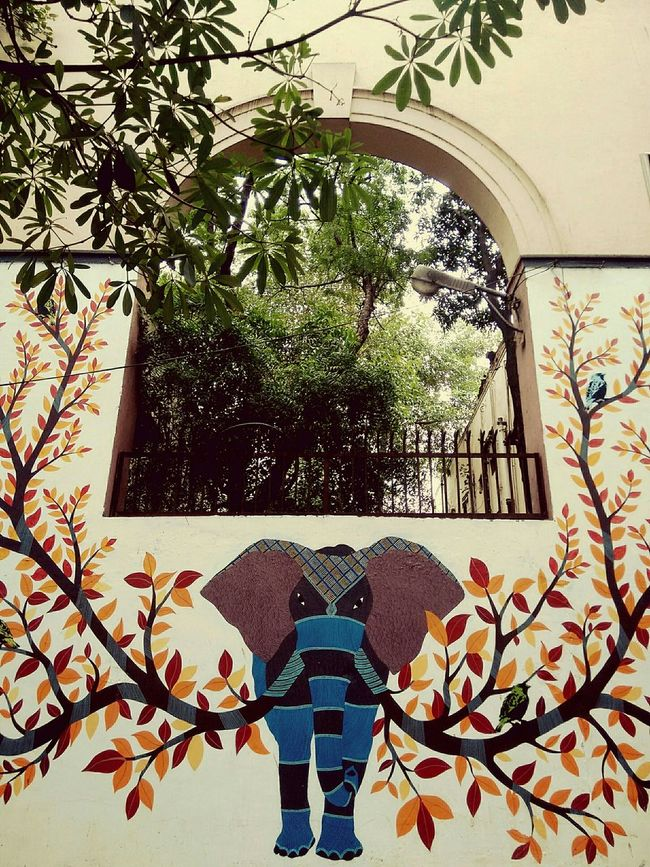 Details of wall mural by rakesh memrot made in lodhi colony art district. It is done in gond art, a form of folk art of the gond tribe of central india. The elephant depicts life. The mural depicts the need of preserving the natural habitat which supports life of birds and animals From My Point Of View India DelhiMural Art Folk Art  Streetphotography Street Art Wall Murals Art DelhiGram Delhidiaries Elephant Art Detail Streets Of Delhi Mural Lodhicolony