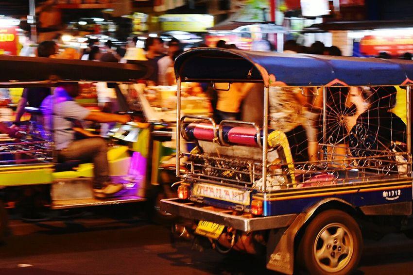 Tuktuk passing by crowd Tuktuk Thailand Night City Street Market Road Street Outdoors City Life Chinatown Bangkok Nightphotography Mobility In Mega Cities