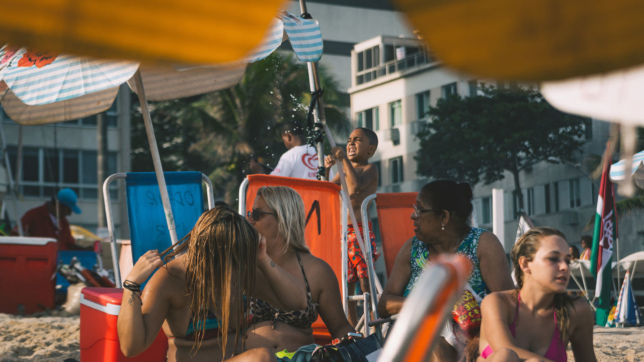 This little fella has some trouble with the water there. I guess he's trying to fix the leak. Adult Architecture Boy Building Exterior Built Structure City Day Enjoyment Friendship Happiness Large Group Of People Leak Leisure Activity Lifestyles Men Outdoors People Real People Smiling The Street Photographer - 2017 EyeEm Awards Togetherness Water Women Young Adult Young Women The Street Photographer - 2017 EyeEm Awards Live For The Story