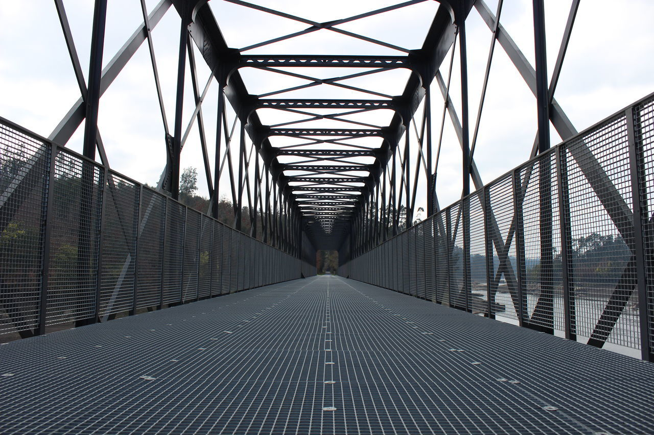 bridge - man made structure, connection, the way forward, architecture, diminishing perspective, built structure, transportation, day, suspension bridge, outdoors, no people, footbridge, sky
