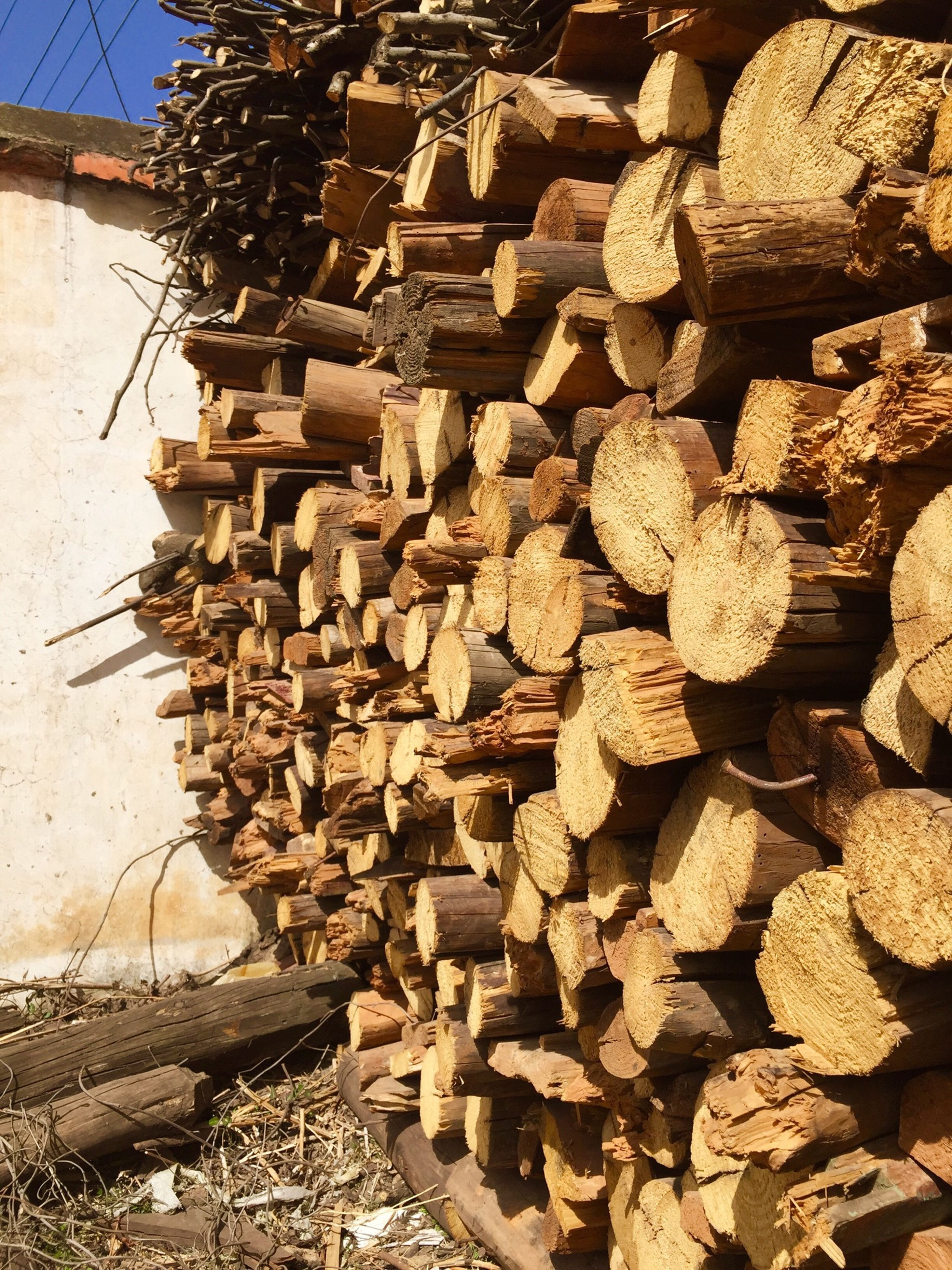 large group of objects, stack, abundance, firewood, deforestation, lumber industry, log, timber, wood - material, heap, stone - object, environmental issues, woodpile, fuel and power generation, day, outdoors, pile, fossil fuel, arrangement, sunlight