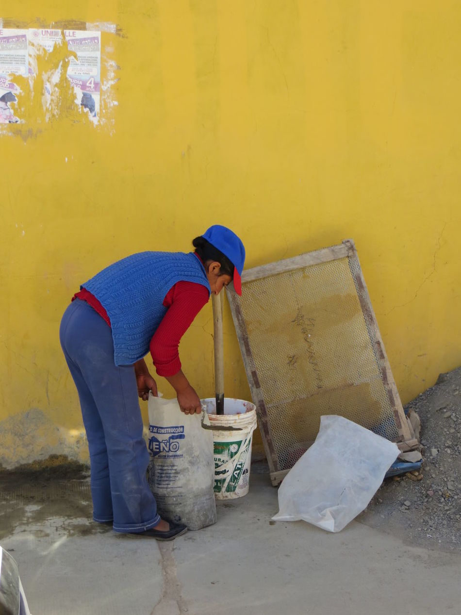 Bolivia Casual Clothing Day Full Length Outdoors Yellow Colorful City Colorful Wall Building The Color Of Business TakeoverContrast TUPIZA Working Hard Working Woman Young Adult Lady Working Hands Street Streetphotography Contrasting Colors Working Working Day WorkingHard Concrete