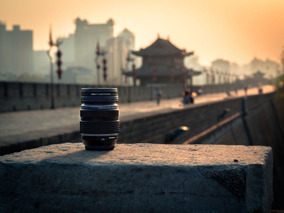 Photography in China. My main lens for almost every thing. M.Zuiko 12-40mm Pro 2.8 MFT Ancient Civilization Building Exterior Camera Camera Lens Citywalls Focus On Foreground M.zuiko M.zuiko 12-40mm F2.8 Pro No People Olympus Olympus OM-D E-M5 Mk.II Outdoors Photography In China Sunset Vignette Xi'an