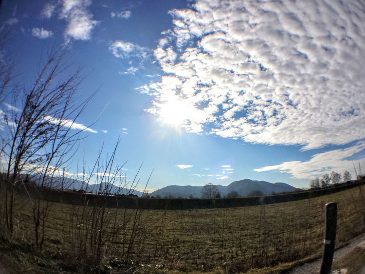 Beauty In Nature Cloud - Sky Day Fish Eye Fish Eye Lens Grass Landscape Nature No People Outdoors Scenics Sky Sun Sunbeam Sunlight Tranquil Scene Tranquility