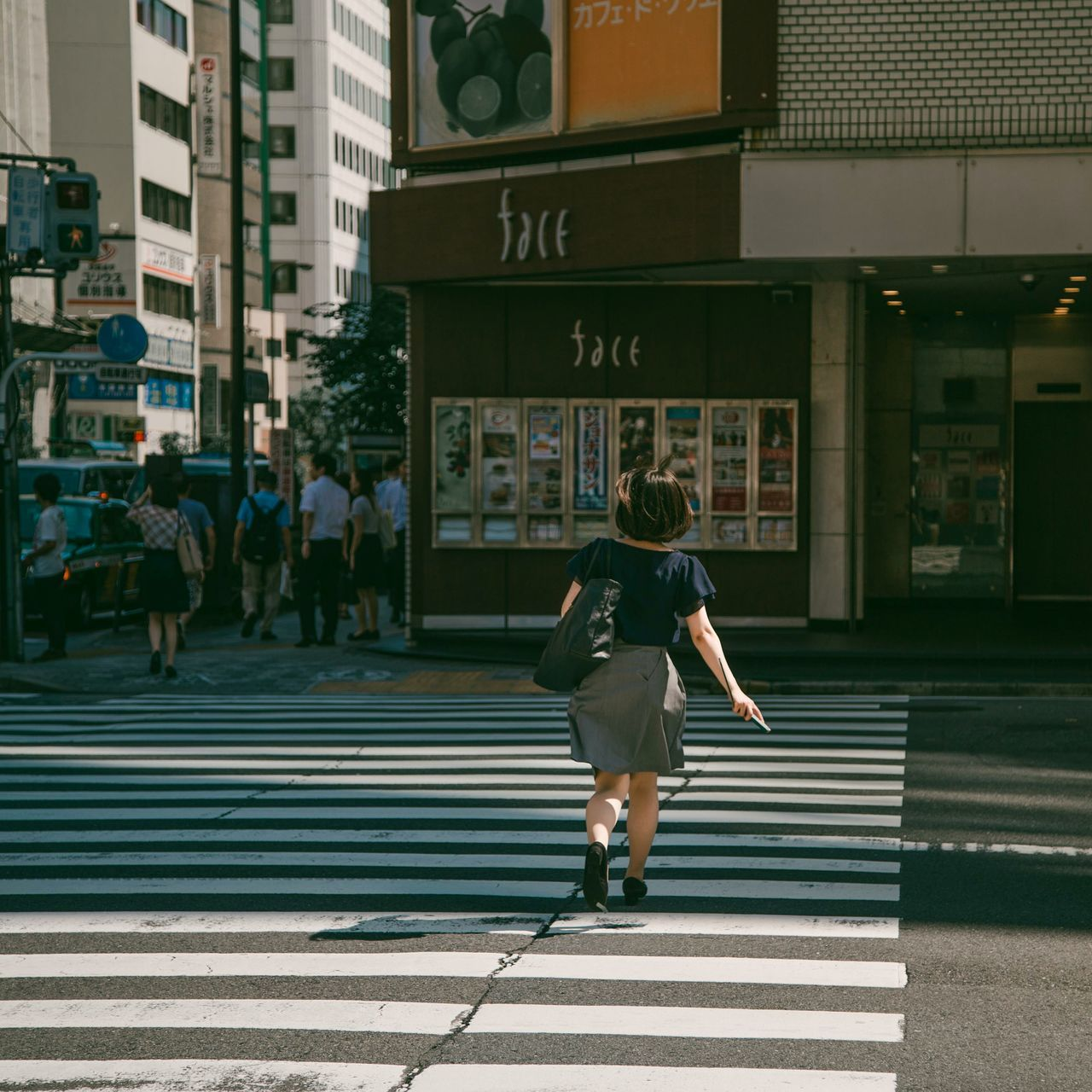 Streets of Tokyo Tokyo Street Photography Tokyo Japan Street Photography City Rear View Outdoors Lost In City Light Collection Light And Shadow Road Zebra Crossing Bustle One Woman Only Walking One Person Architecture City Life