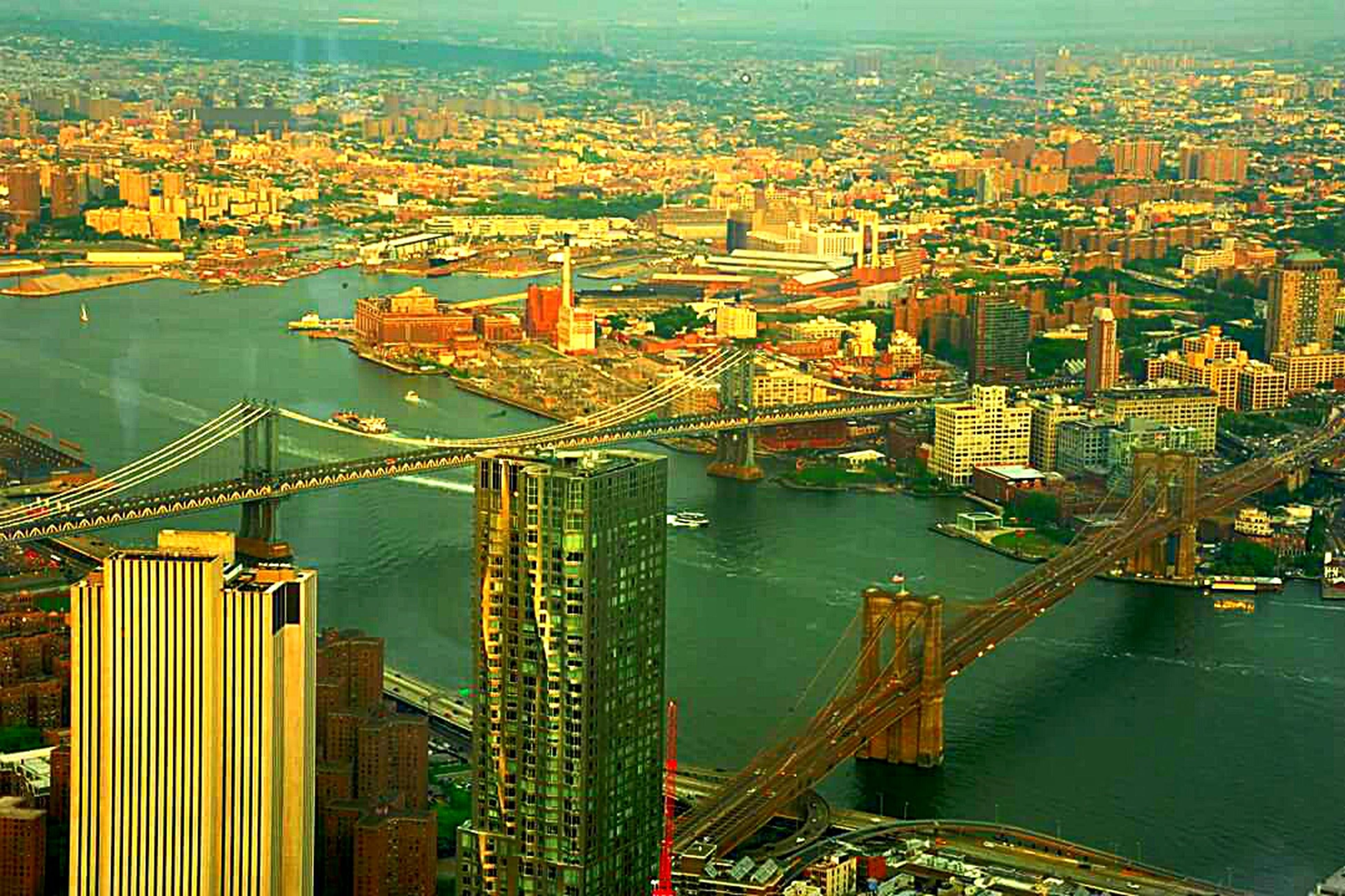 architecture, built structure, city, building exterior, cityscape, high angle view, water, bridge - man made structure, aerial view, river, connection, capital cities, travel destinations, famous place, transportation, illuminated, crowded, city life, travel, engineering
