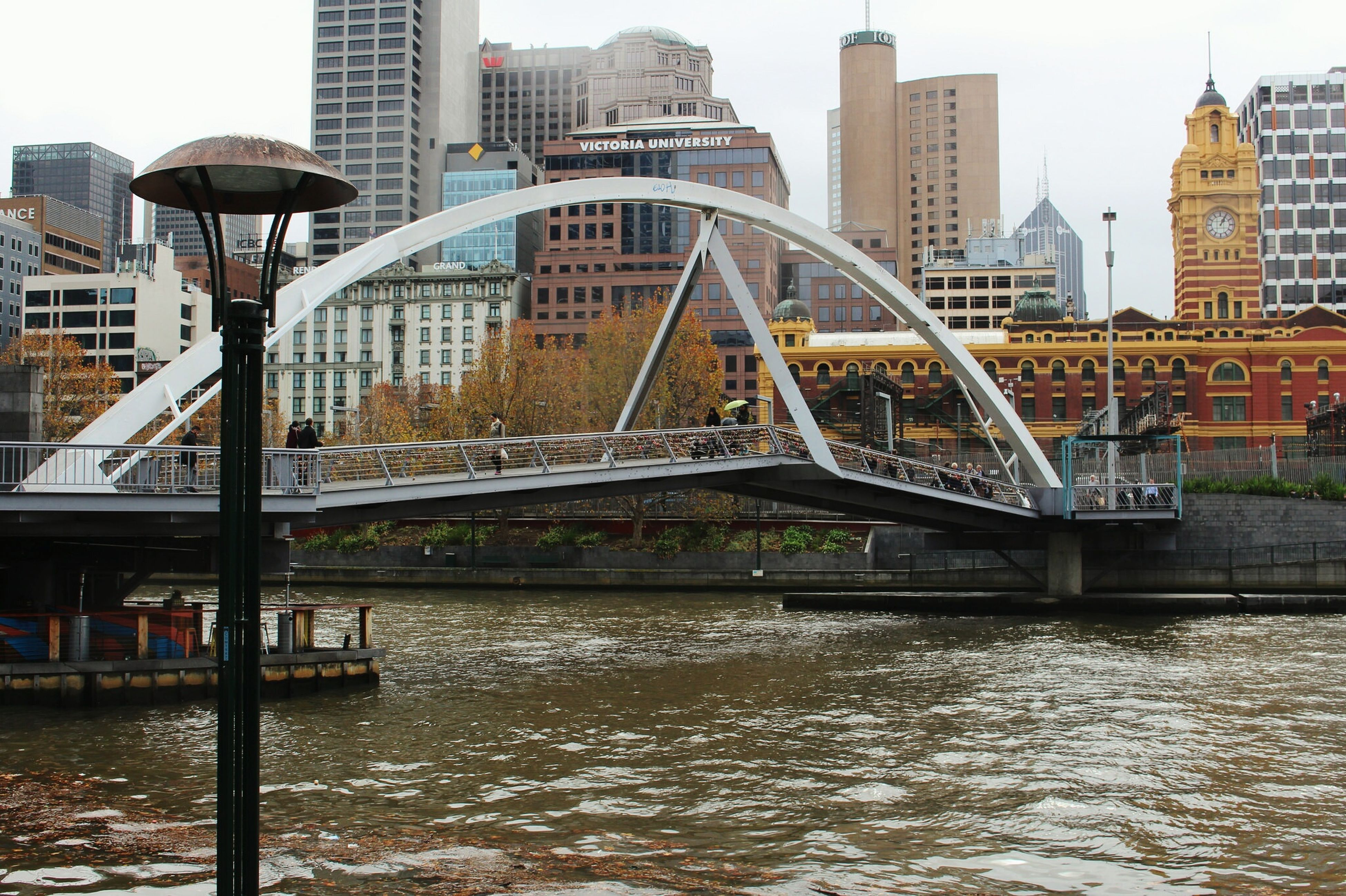 architecture, building exterior, built structure, city, water, waterfront, river, cityscape, skyscraper, capital cities, modern, office building, residential building, city life, travel destinations, building, bridge - man made structure, tower, famous place, connection