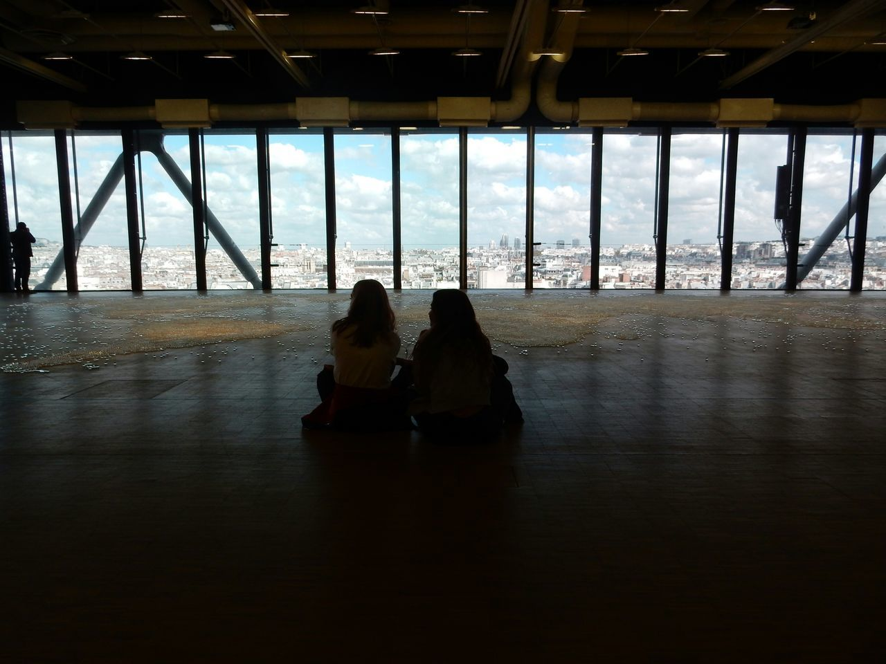 indoors, real people, window, sitting, women, rear view, lifestyles, day, built structure, togetherness, architecture, leisure activity, two people, friendship, water, men, sky, sea, nature, people