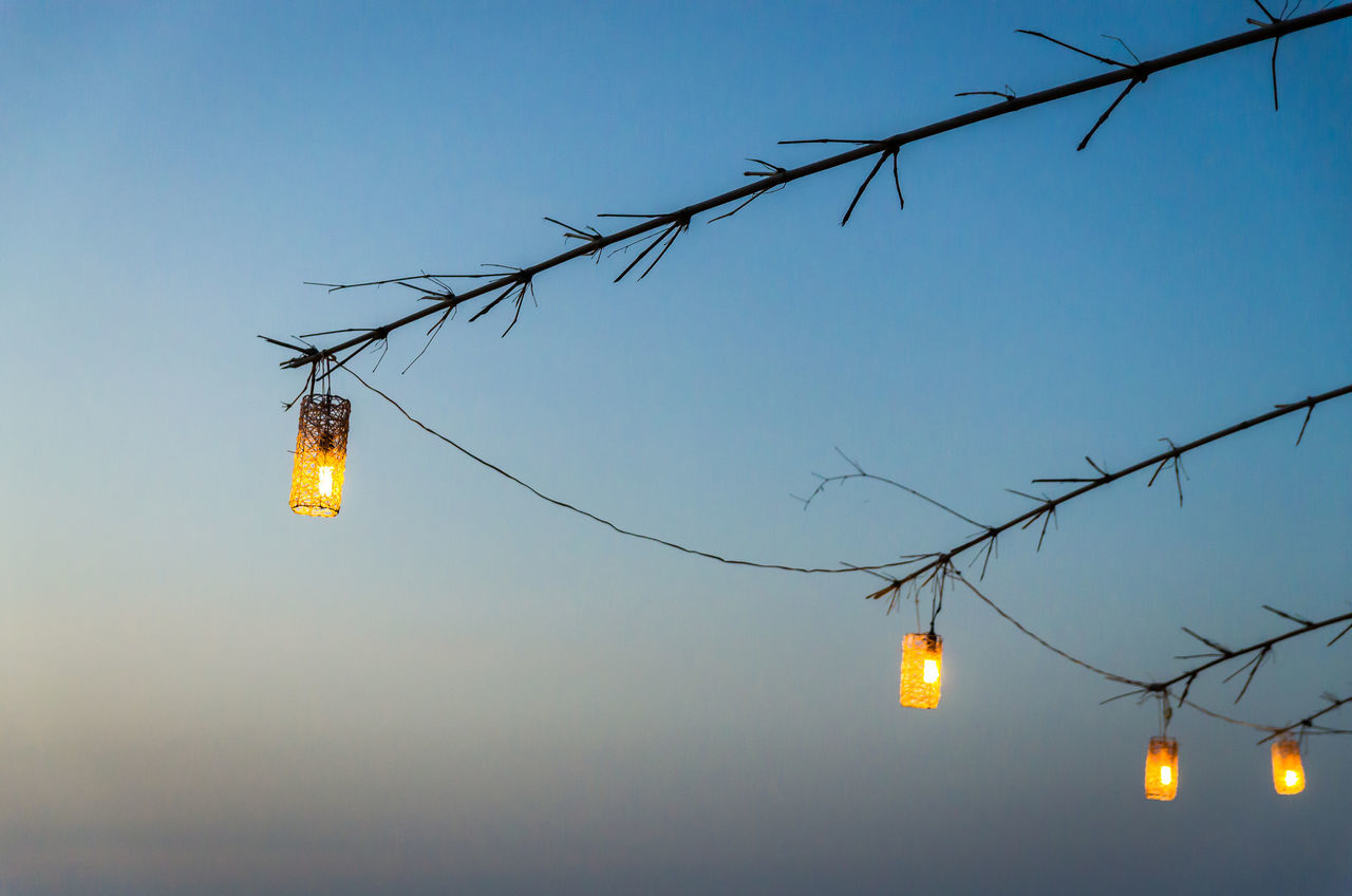 Lamps over the blue sky Backgrounds Cable Clear Sky Dawn Dusk Dusk Sky Electricity  Illuminated Lighting Equipment Low Angle View No People Outdoors Phu Quoc Sky Vietnam Wallpaper