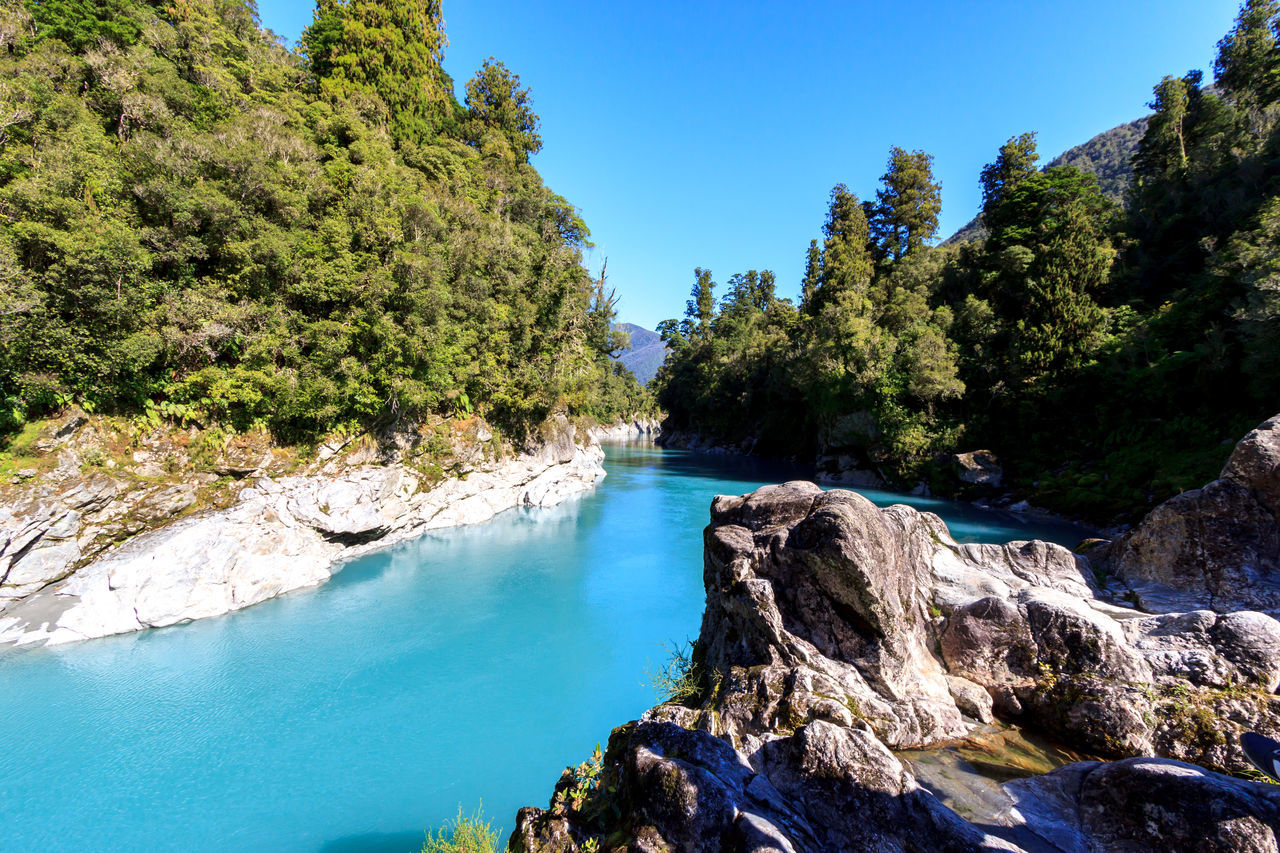 The blue waters at the Hokitika Gorge Beauty In Nature Blue Blue Water Clear Sky Day Eye4photography  EyeEm Best Shots EyeEm Nature Lover Forest Hot Spring Landscape Mountain Nature No People Outdoors Rock - Object Scenics Sky Sunlight Tranquil Scene Tranquility Tree Water