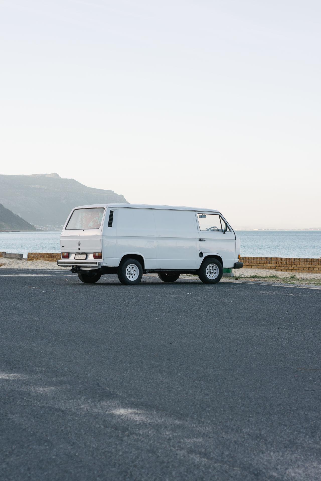 VW Kombi Parked by the beach. Beach Vw Camper Van VW Kombi White Car First Eyeem Photo