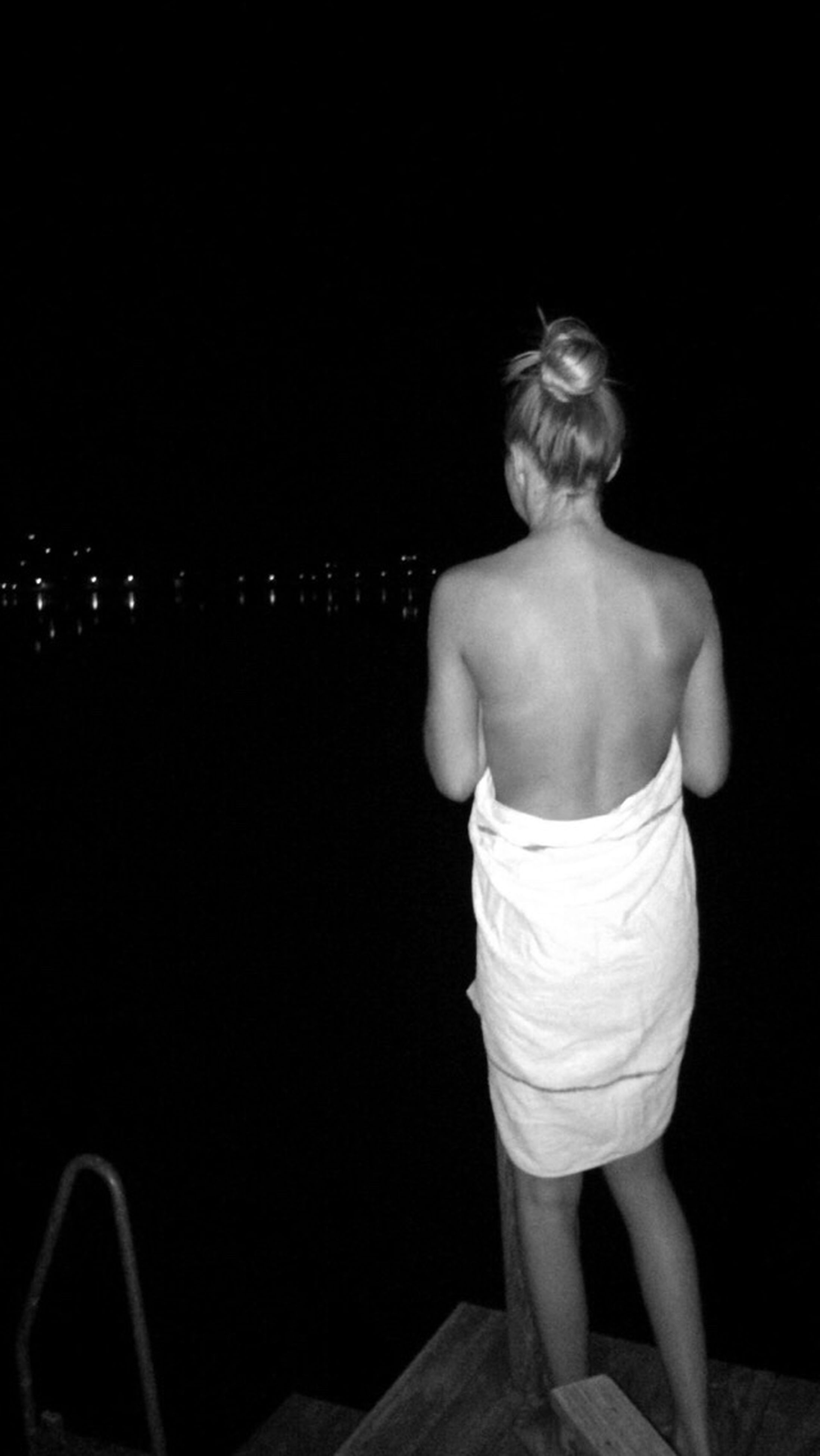 rear view, standing, night, full length, illuminated, water, vacations, in front of, tourism, tranquil scene, solitude, tranquility, scenics