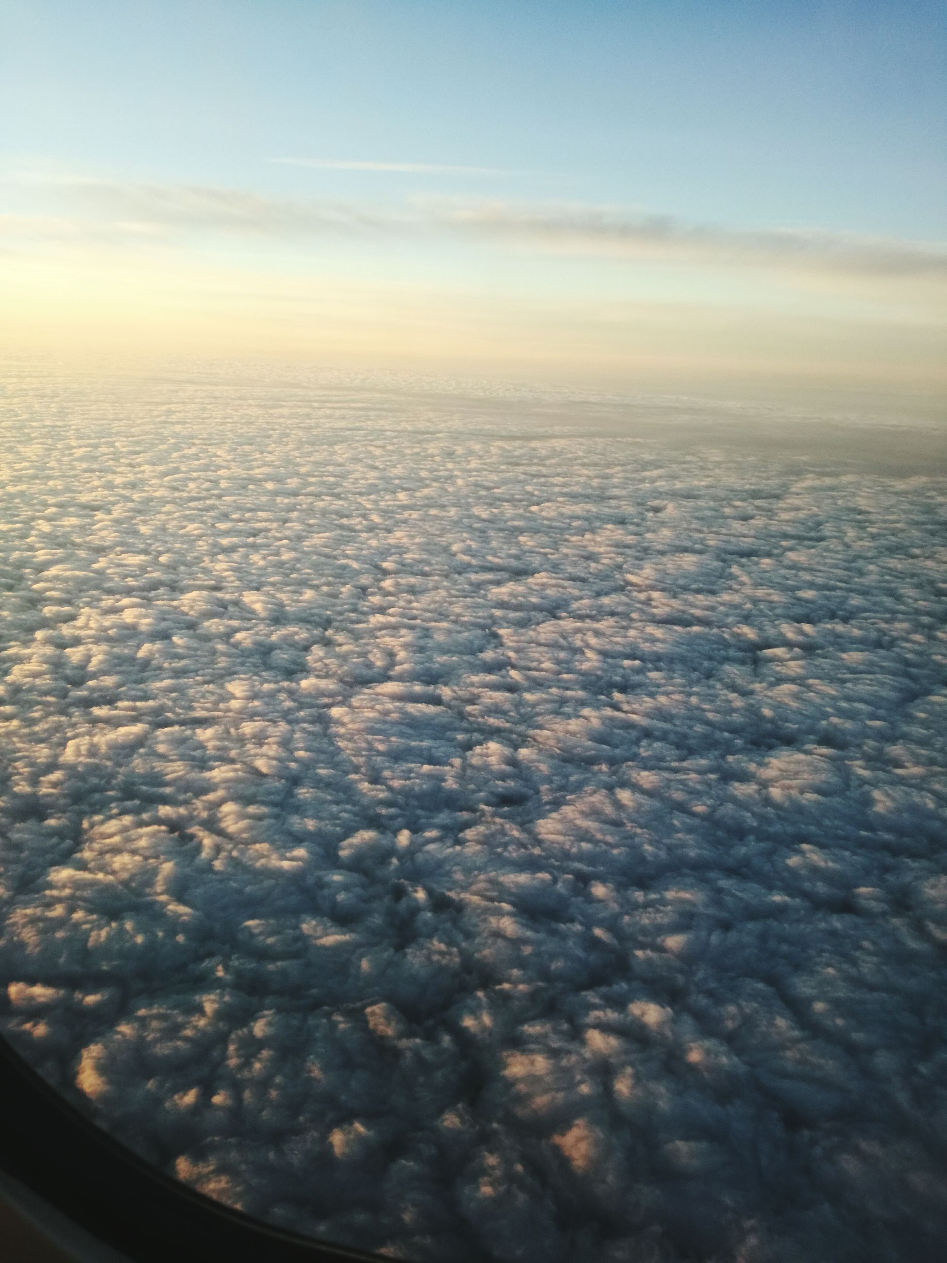 aerial view, nature, beauty in nature, scenics, sky, sunset, airplane, tranquility, no people, outdoors, tranquil scene, landscape, air vehicle, day, airplane wing