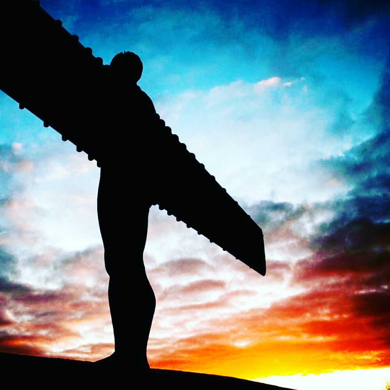 Silhouette Sunset Cloud - Sky One Man Only Sky Passion Dramatic Sky Outdoors Nature Beauty In Nature Day Angel Wings Angel Statue Angel Of The North