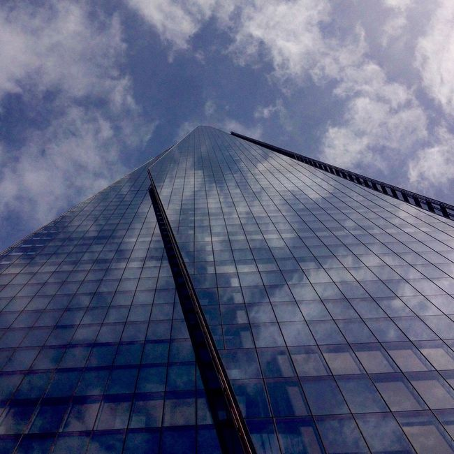 shard of glass Architecture glass Buildings Building Exterior Glass Building Glass Building And The Sk Glass Reflection Clouds Mirrored Reflection