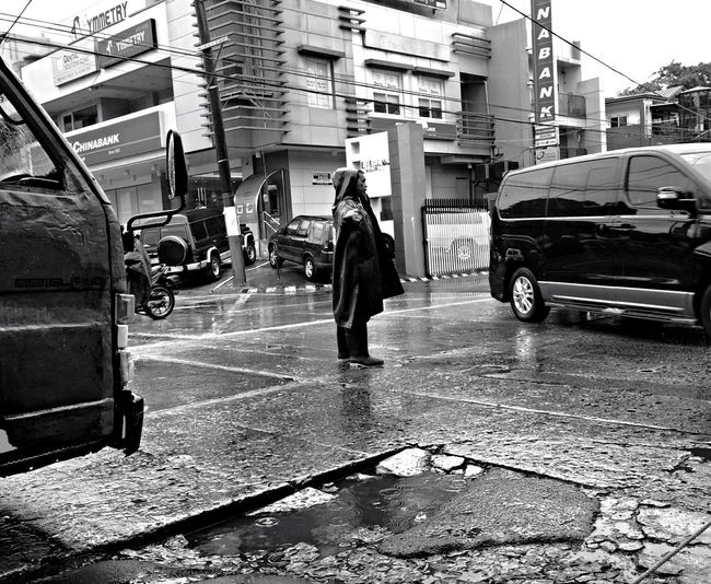 Work Traffic Enforcer Sacrifice Rain Rainy Days Black And White Traffic Real People Real Life EyeEmBestPics