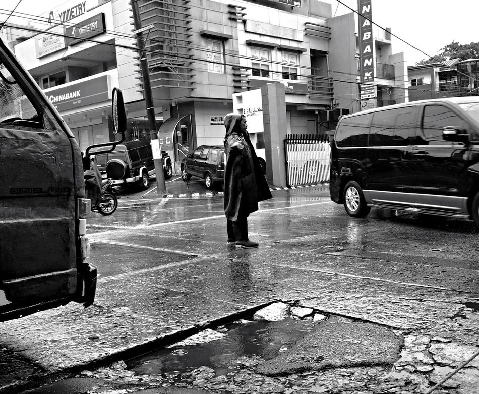 Work Traffic Enforcer Sacrifice Rain Rainy Days Black And White Traffic Real People Real Life EyeEmBestPics