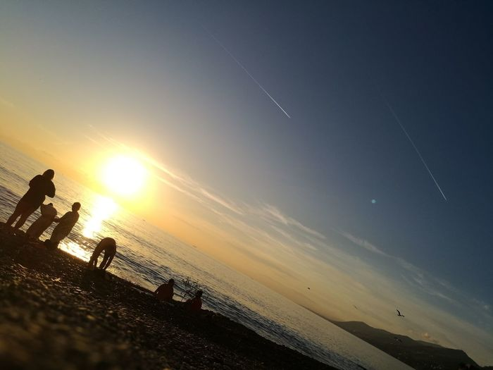 Sunset Beach Sky Sun Outdoors Sand Nature Sea People Beauty In Nature Day