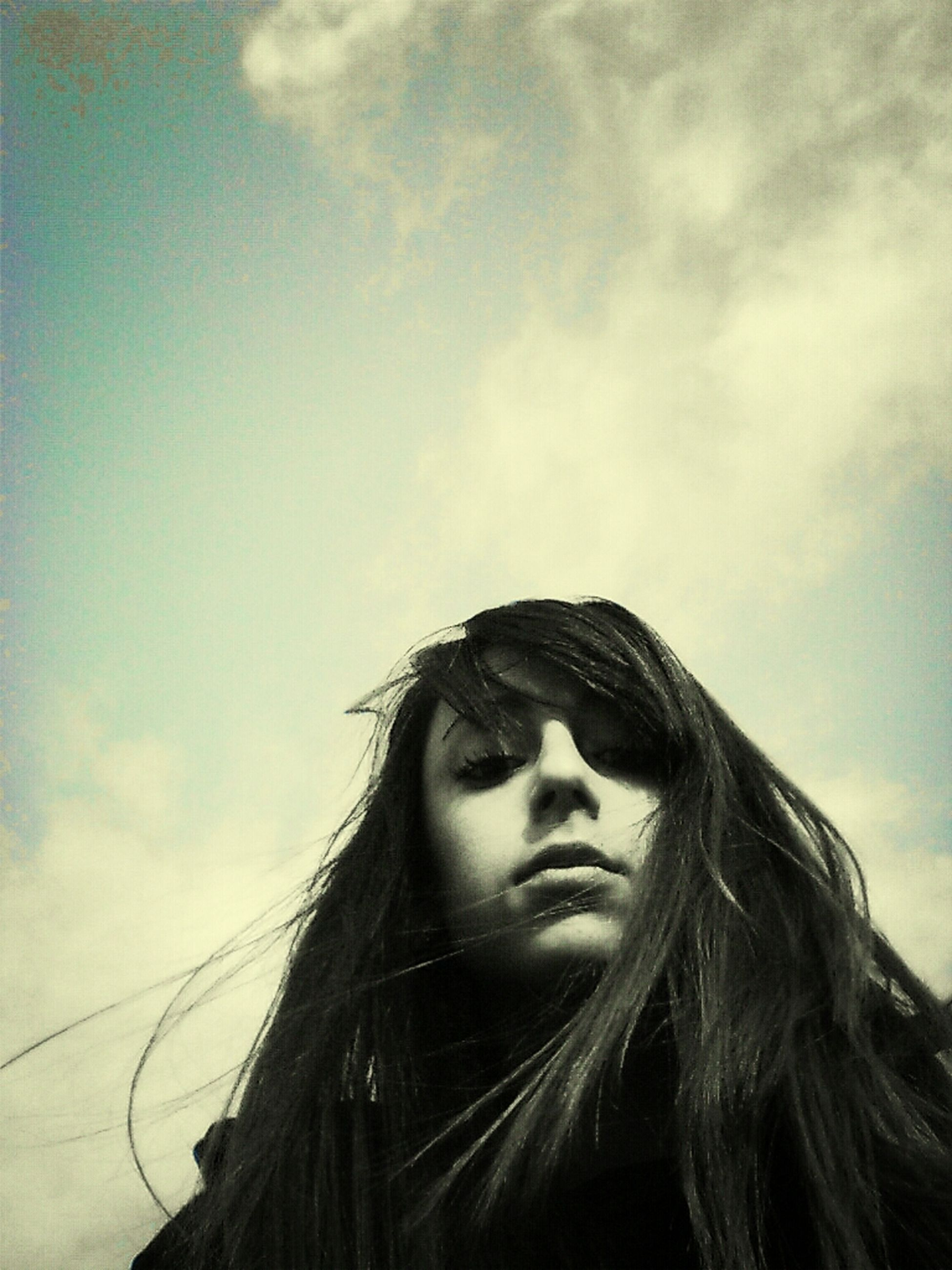 young adult, person, headshot, young women, looking at camera, portrait, long hair, low angle view, sky, lifestyles, front view, leisure activity, head and shoulders, day, human face, contemplation, smiling