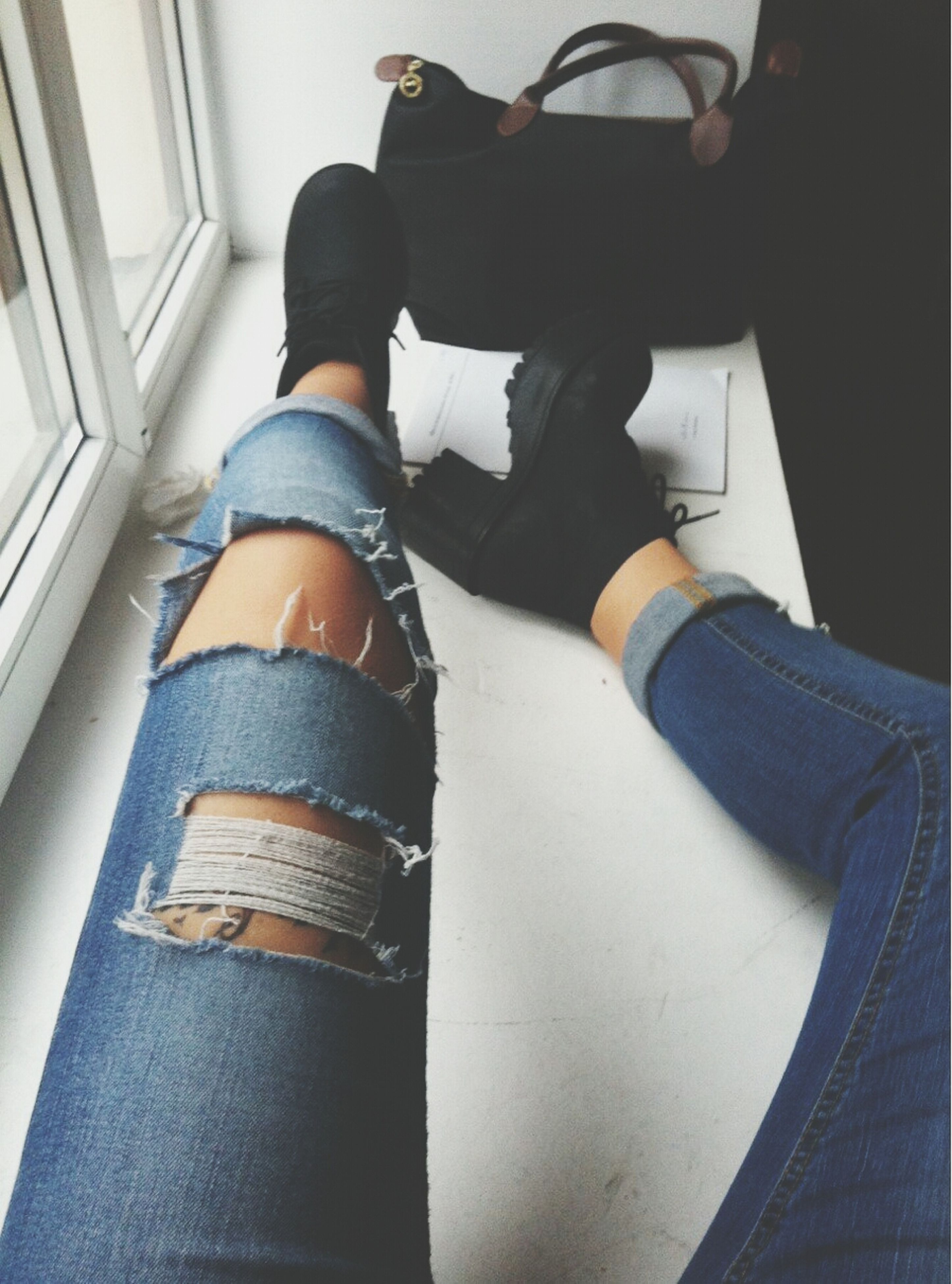 low section, person, indoors, lifestyles, shoe, jeans, leisure activity, standing, men, casual clothing, human foot, high angle view, personal perspective, sitting, footwear, unrecognizable person