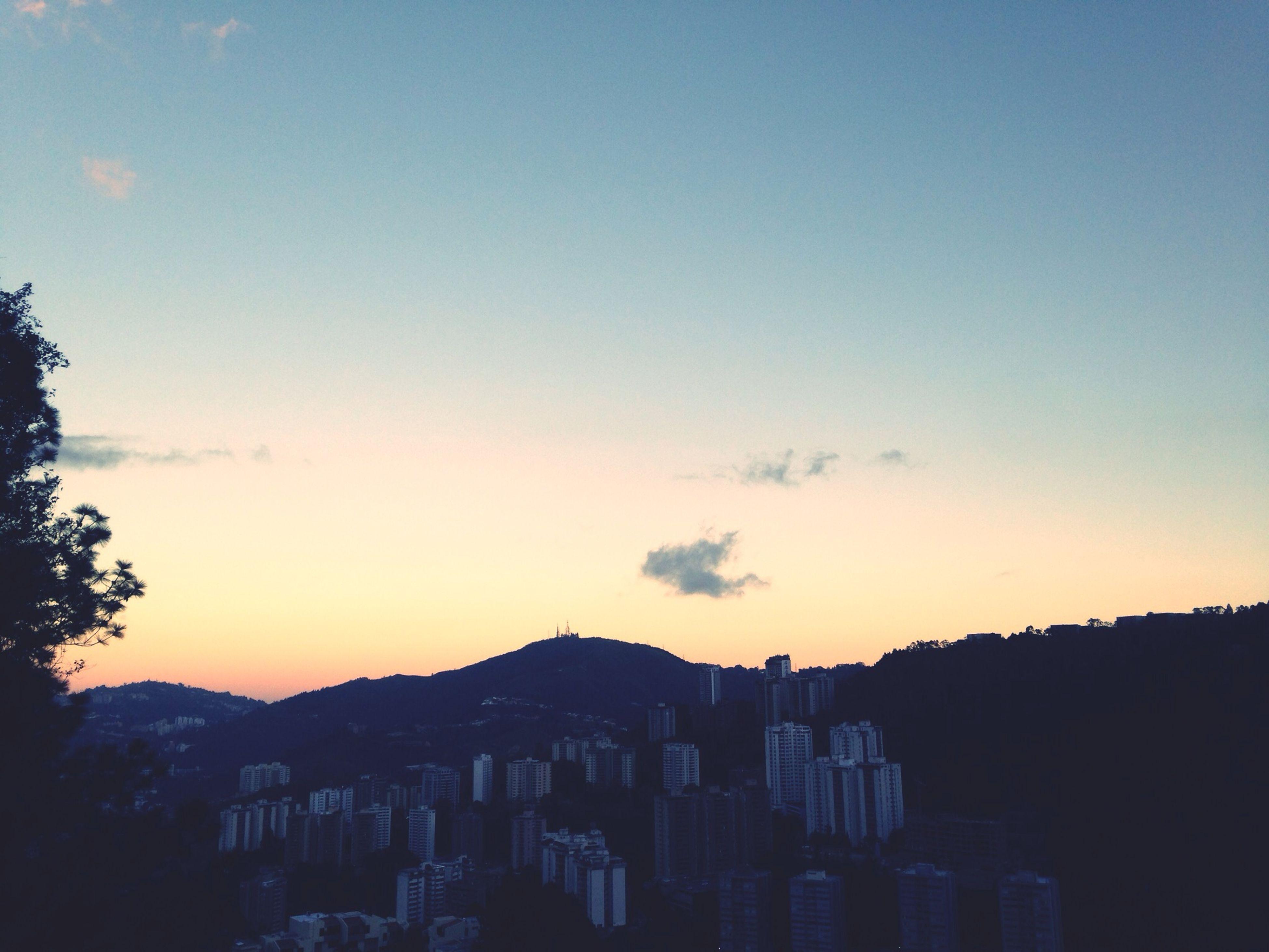 building exterior, architecture, built structure, sunset, city, cityscape, copy space, sky, silhouette, residential structure, residential building, clear sky, orange color, residential district, building, no people, outdoors, dusk, blue, mountain