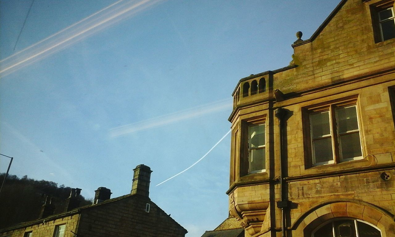 I love how the airplane cloud curves! Airplane Clouds Trees Streetphotography Street Light Building Building Exterior Bank Architectureporn Architecture Spring Blue Sky Bus Ride Bus Buildings & Sky Taking Photos Here Belongs To Me Hebden Bridge No People Creative Light And Shadow EyeEm Best Shots Sunny Afternoon Sunshine PhonePhotography Town