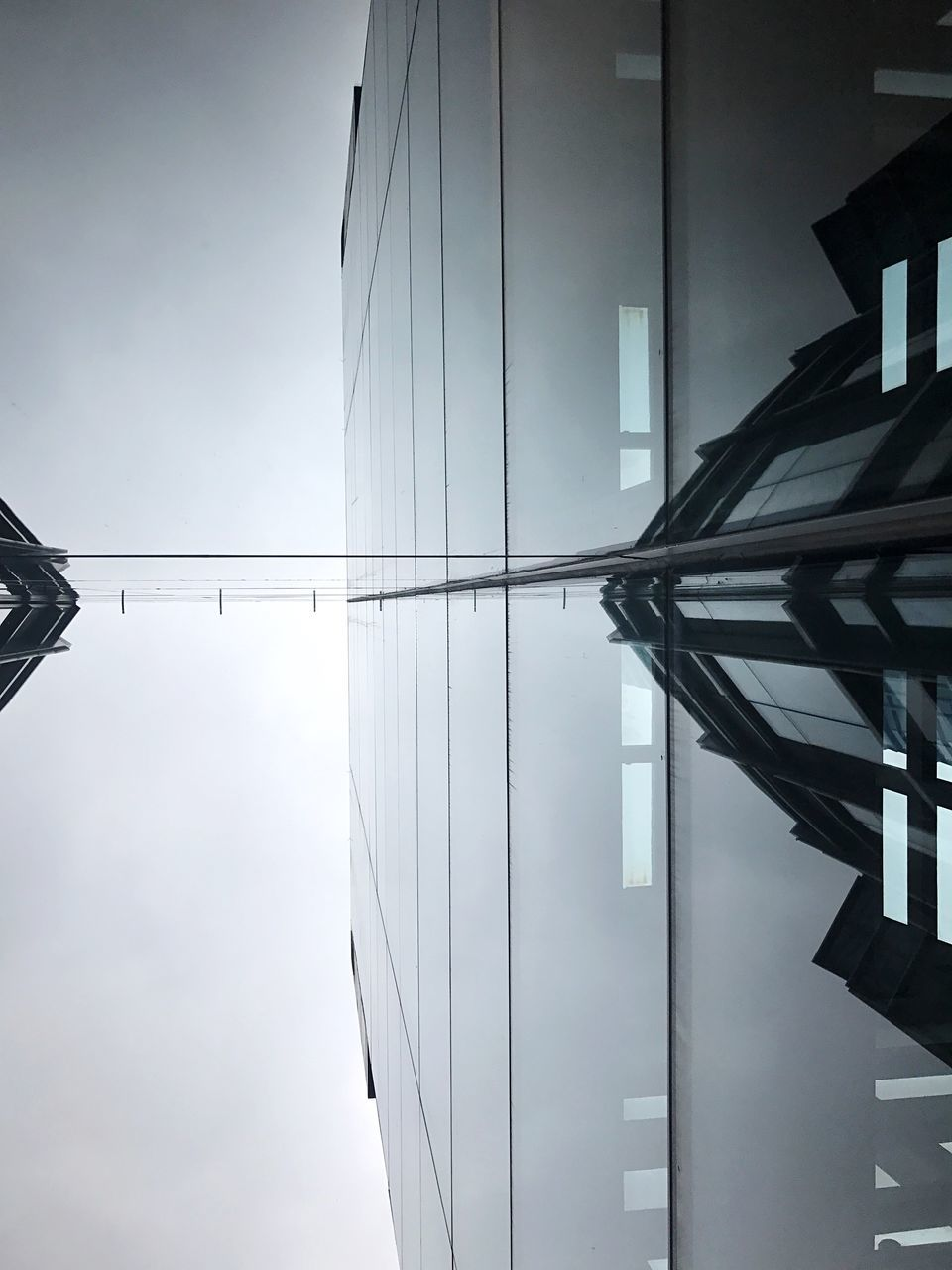 sky, architecture, built structure, no people, connection, outdoors, day, building exterior, low angle view, modern