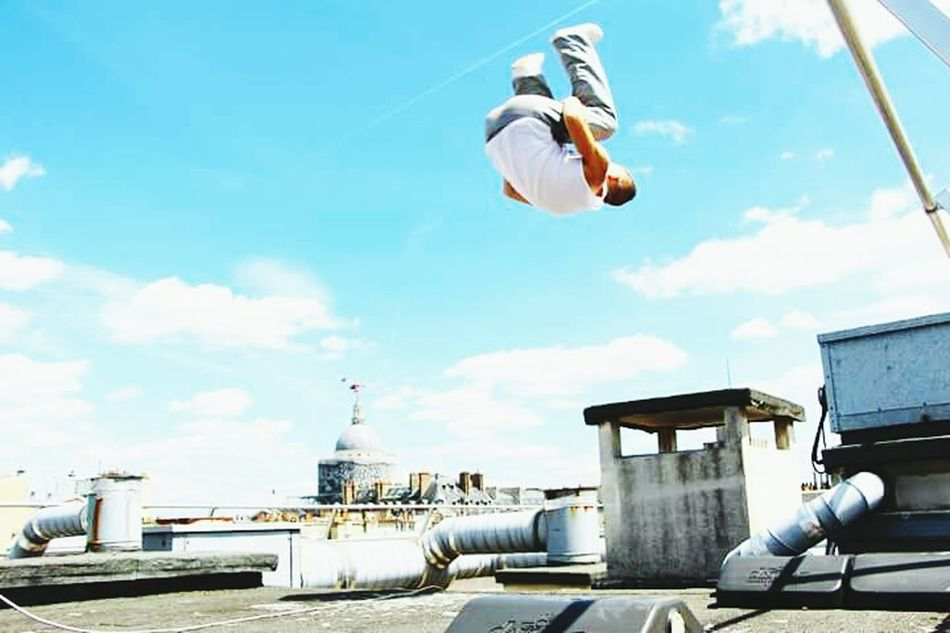 Frontflip on the Parisian Rooftop Industry Sky Day Adult Outdoors One Person Adults Only Young Adult People Athlete Freerunning Training Traceur Frontflip Parkour And Free Running Rooftop Urbexphotography Exploring Parkourlife Sunlight Urban Lifestyle Sports Photography Urbex France Urban Skyline Parkour
