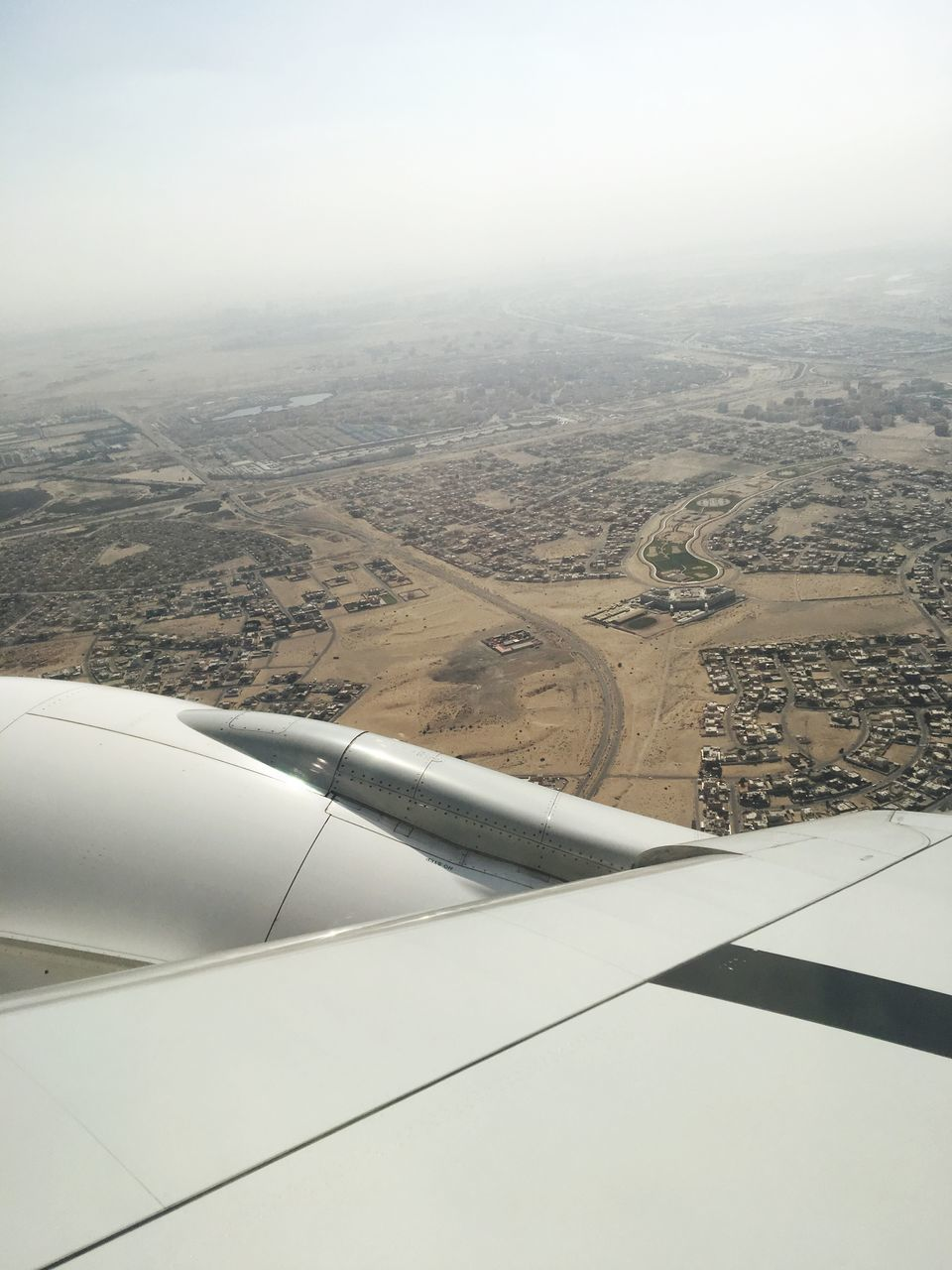 aerial view, airplane, transportation, landscape, aircraft wing, air vehicle, day, mode of transport, journey, nature, jet engine, travel, outdoors, no people, beauty in nature, flying, mid-air, airplane wing, scenics, sky, view into land
