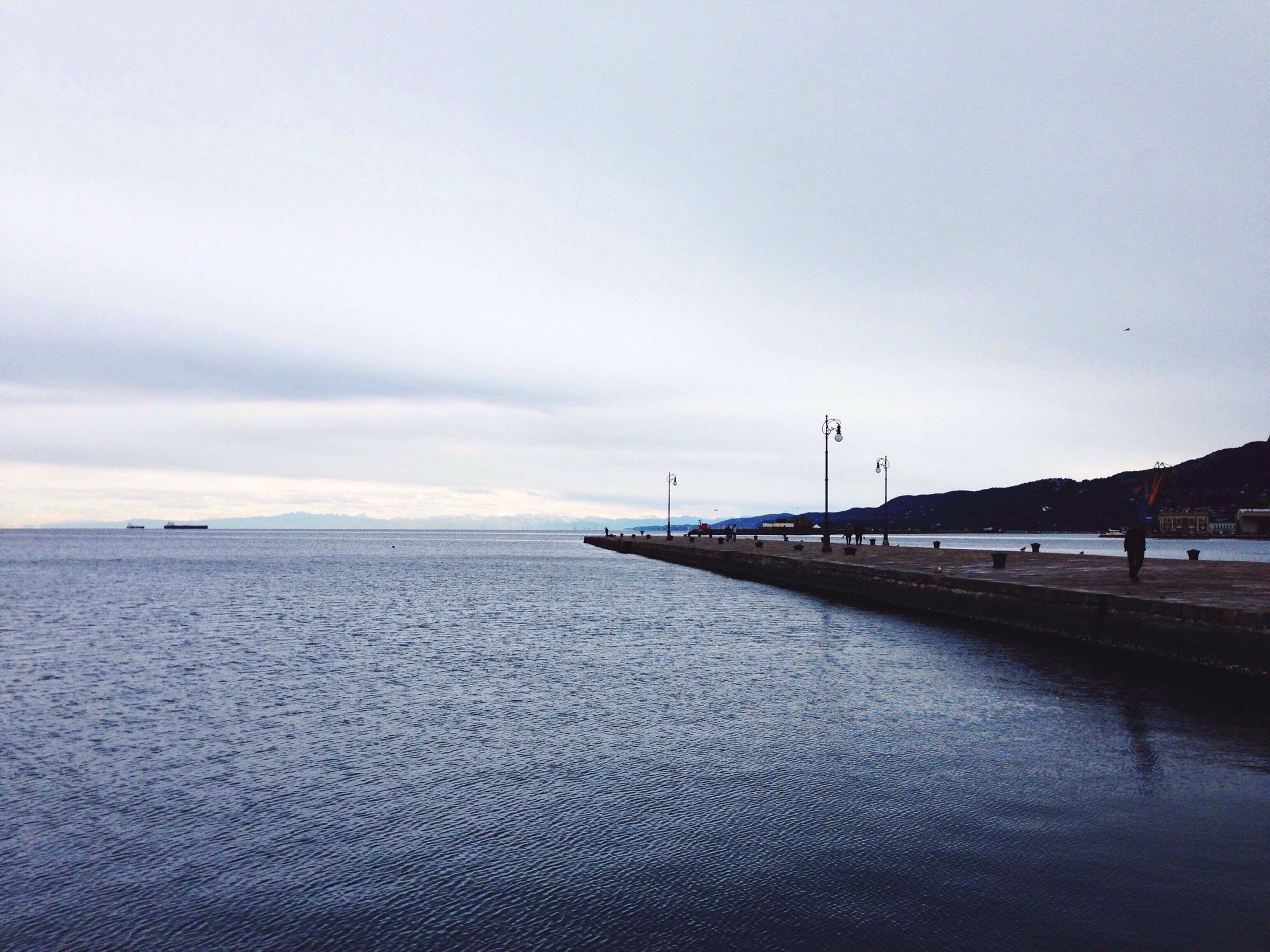 water, sky, sea, tranquil scene, tranquility, scenics, cloud - sky, nature, waterfront, beauty in nature, transportation, cloudy, pier, overcast, horizon over water, cloud, outdoors, copy space, idyllic, calm