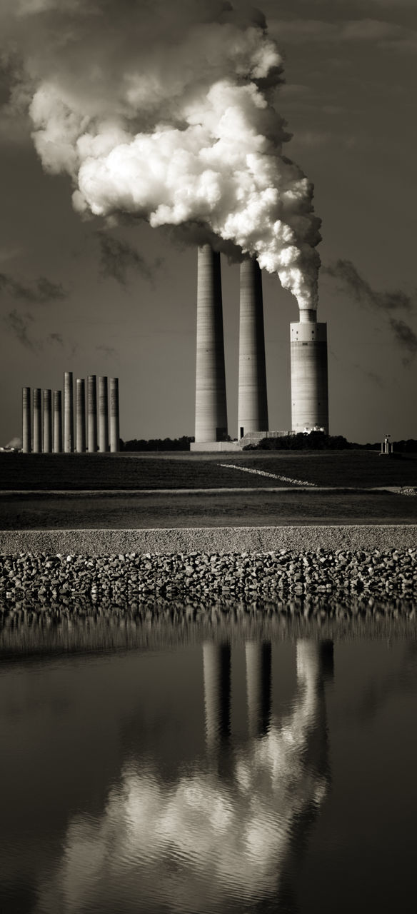 industry, factory, smoke - physical structure, smoke stack, emitting, sky, reflection, architecture, pollution, built structure, no people, water, power station, chimney, day, building exterior, outdoors