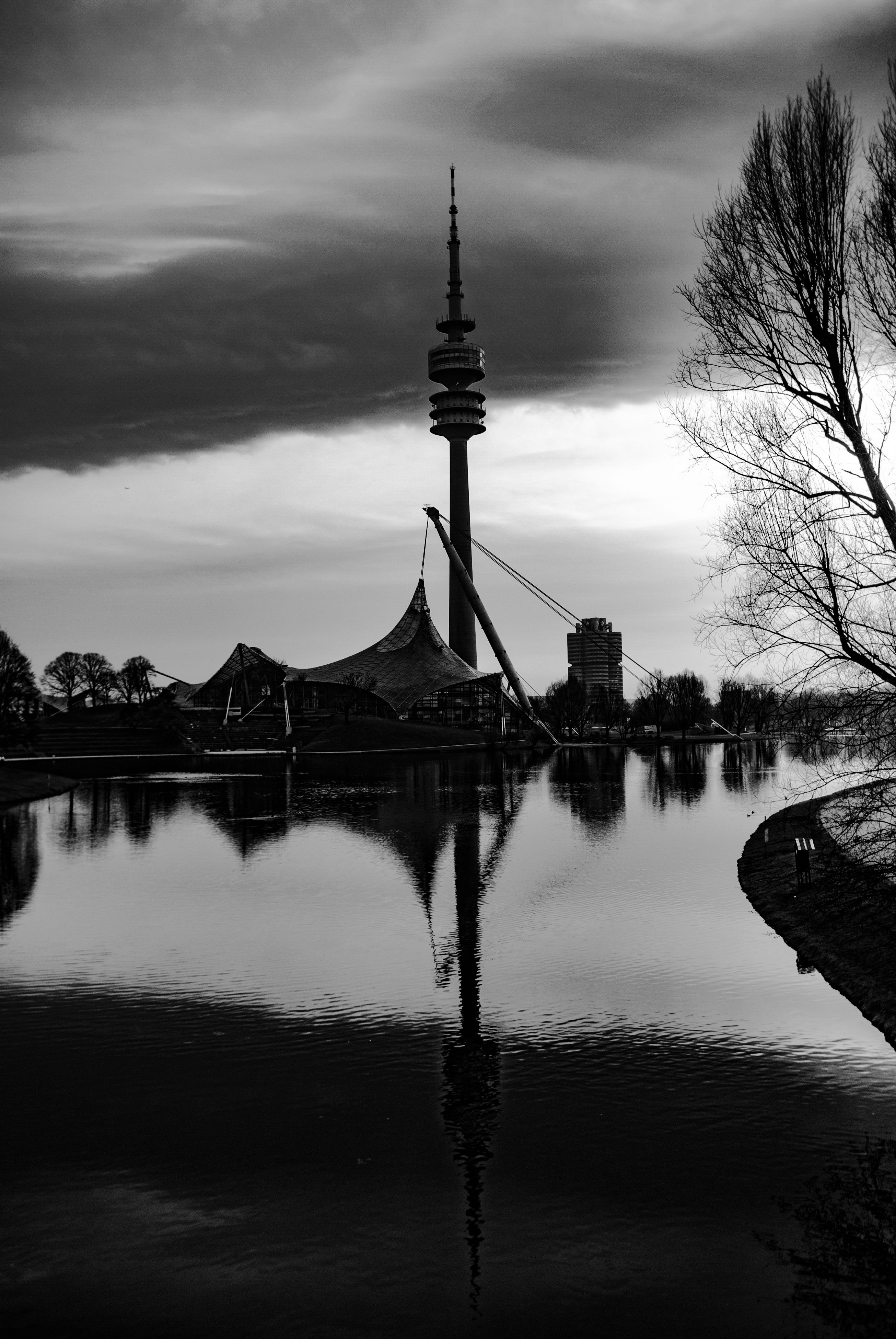 sky, reflection, architecture, water, built structure, travel destinations, building exterior, outdoors, waterfront, river, no people, cloud - sky, winter, nature, day, snow, tree, beauty in nature