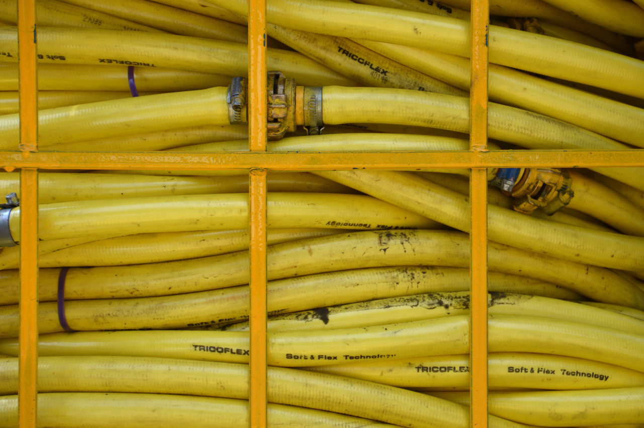 Snake Pit Beautifully Organized Close-up Gathered Hoses Pressed Flowers Snake Pit Tubes Yellow