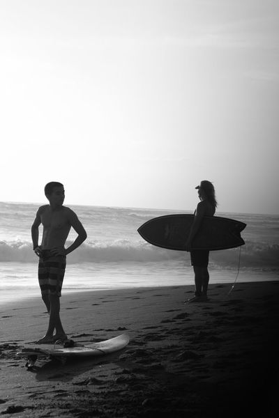 At the beach Sea Two People Beach Real People Full Length Shore Water Horizon Over Water Surfer Lifestyles Men Outdoors Surf