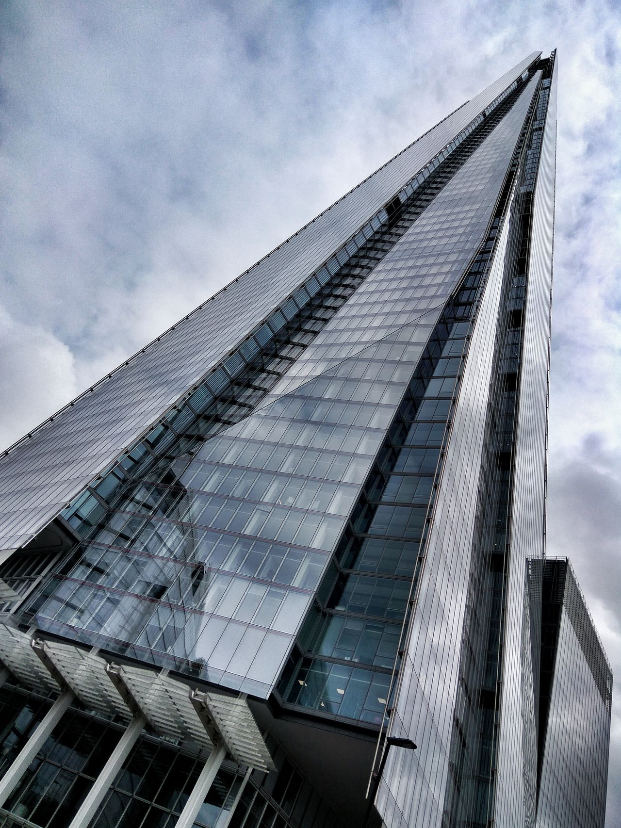 The Shard Sky Low Angle View Architecture Cloud - Sky Built Structure Day No People Outdoors Building Exterior Close-up London Renzo Piano The Shard Cloudy Metal And Glass Modernity Style Class Design Magazine Details Urban Exploration Cold Colors Geometry Waypoint