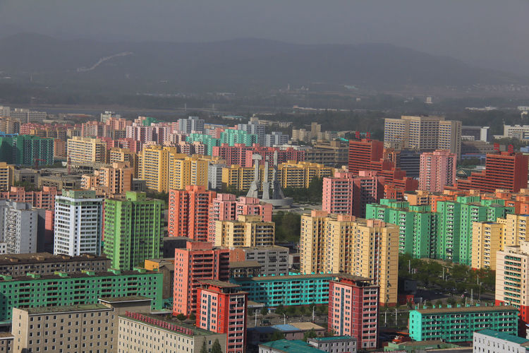 Statue Socialism Sculpture North Korea Photos North Korea Kim Jong Un Kim Jong Il Kim Il Sung Communism ASIA No People Politics And Government Government Propaganda Pyongyang Pyongyang Architecture Korea Dictator City Outdoors Poor  Architecture Sky Flag Home