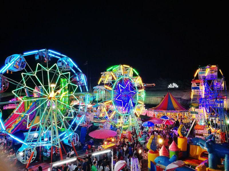 Temple fair last night. Night Illuminated Amusement Park Arts Culture And Entertainment Amusement Park Ride Ferris Wheel Multi Colored Outdoors Sky Low Angle View People Fun Nightlife Night Lights Bangkok Thailand