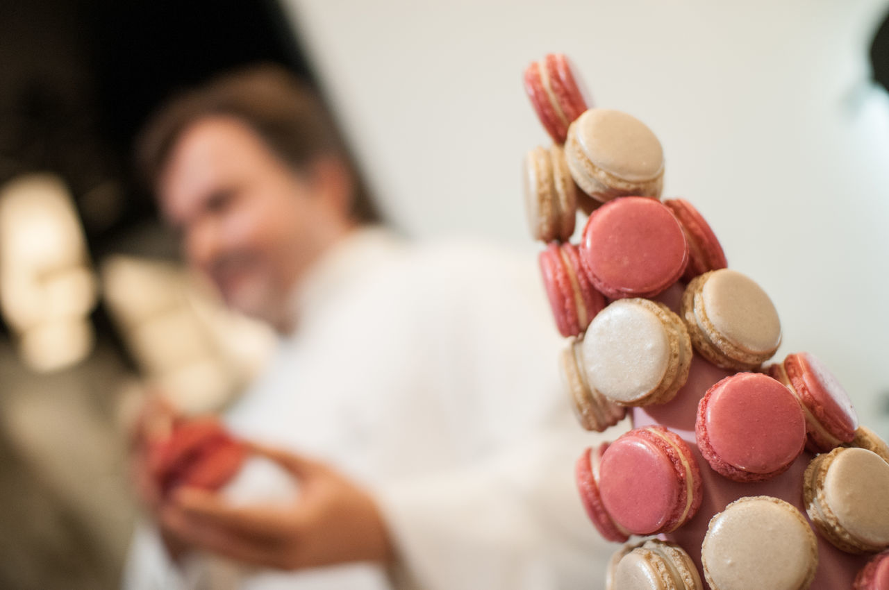 Collection Focus On Foreground Holding Indoors  Large Group Of Objects Macarons Pastry Pastrychef Person Pink Red Selective Focus
