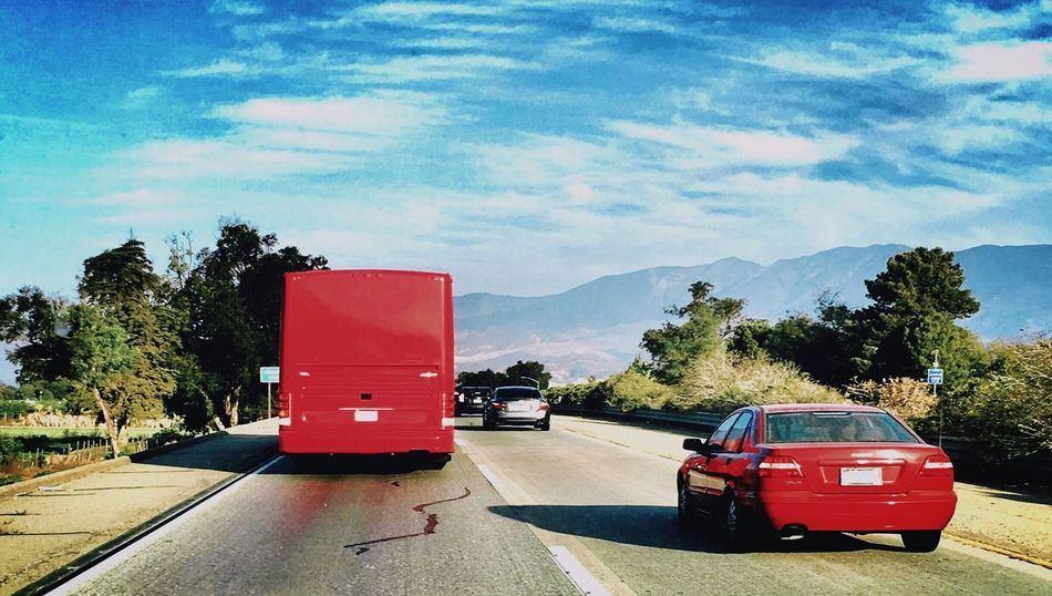 Big Red /little red Red Tourbus Economy Car Highway Big And Small Different Tree Transportation Road Traffic Cone Street Sky Red Mountain Empty Blue Cloud Solitude Outdoors Day Countryside Remote Cloud - Sky