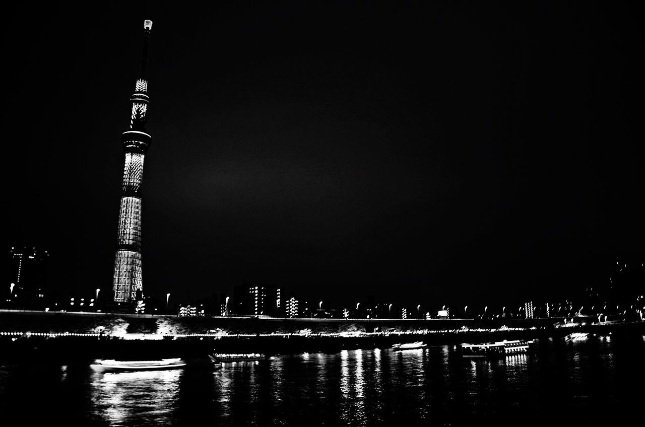 night, water, architecture, built structure, travel destinations, waterfront, building exterior, river, illuminated, skyscraper, sky, outdoors, no people, city, clear sky, modern, nature, urban skyline, cityscape