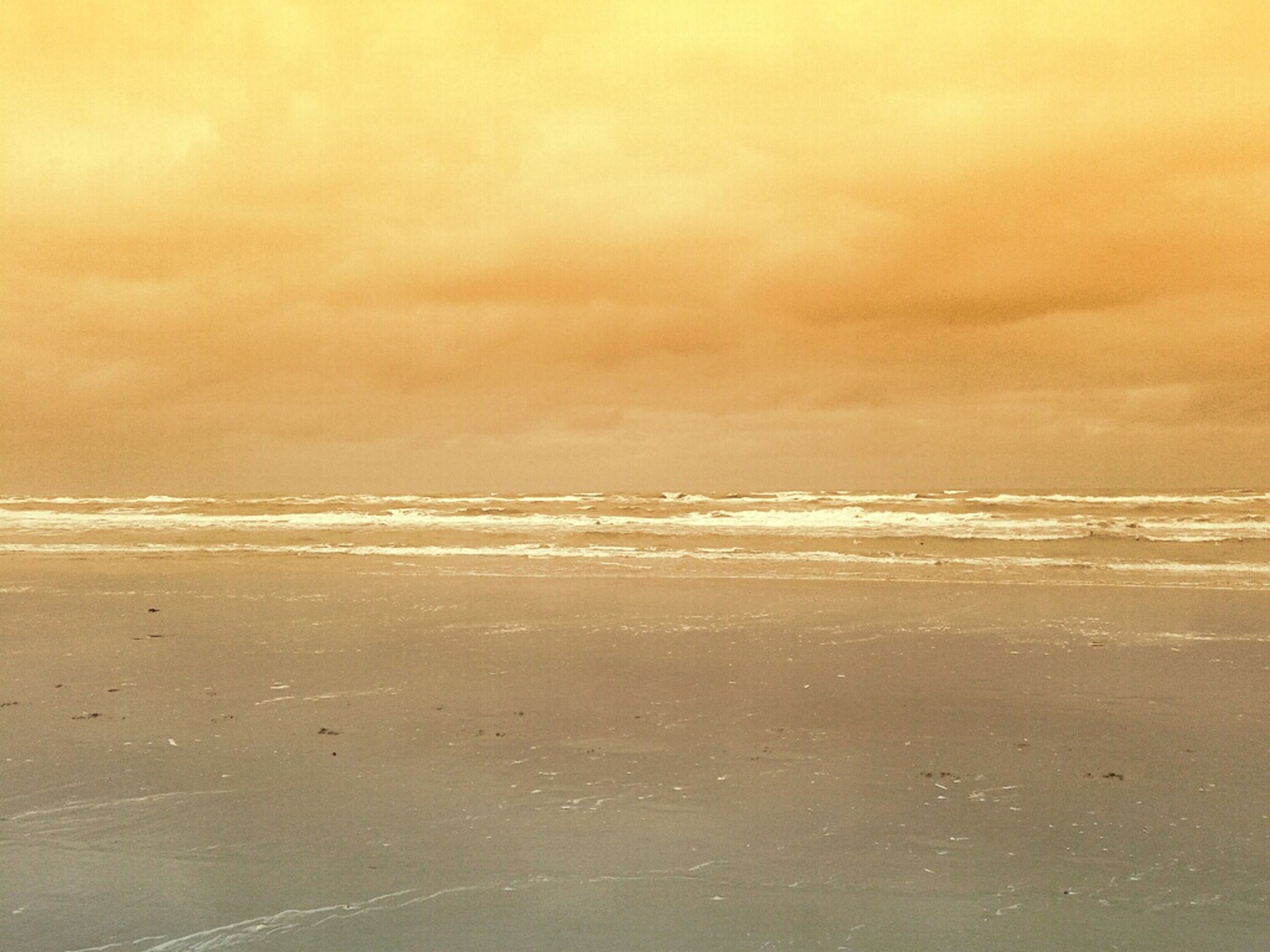 beach, sea, horizon over water, sand, shore, scenics, tranquil scene, tranquility, water, beauty in nature, sky, nature, wave, idyllic, sunset, cloud - sky, coastline, surf, remote, outdoors
