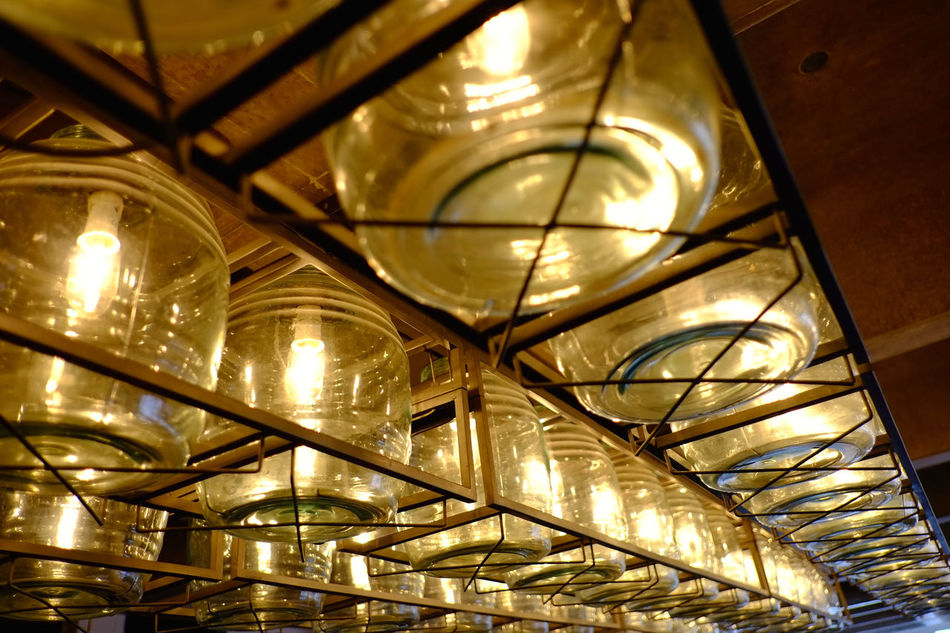 Design elements at modern-style bar/cafe/restaurant Ceiling Close-up Electricity  Glass - Material Hanging Illuminated In A Row Indoors  Interior Design Lantern Lighting Equipment Low Angle View Night No People