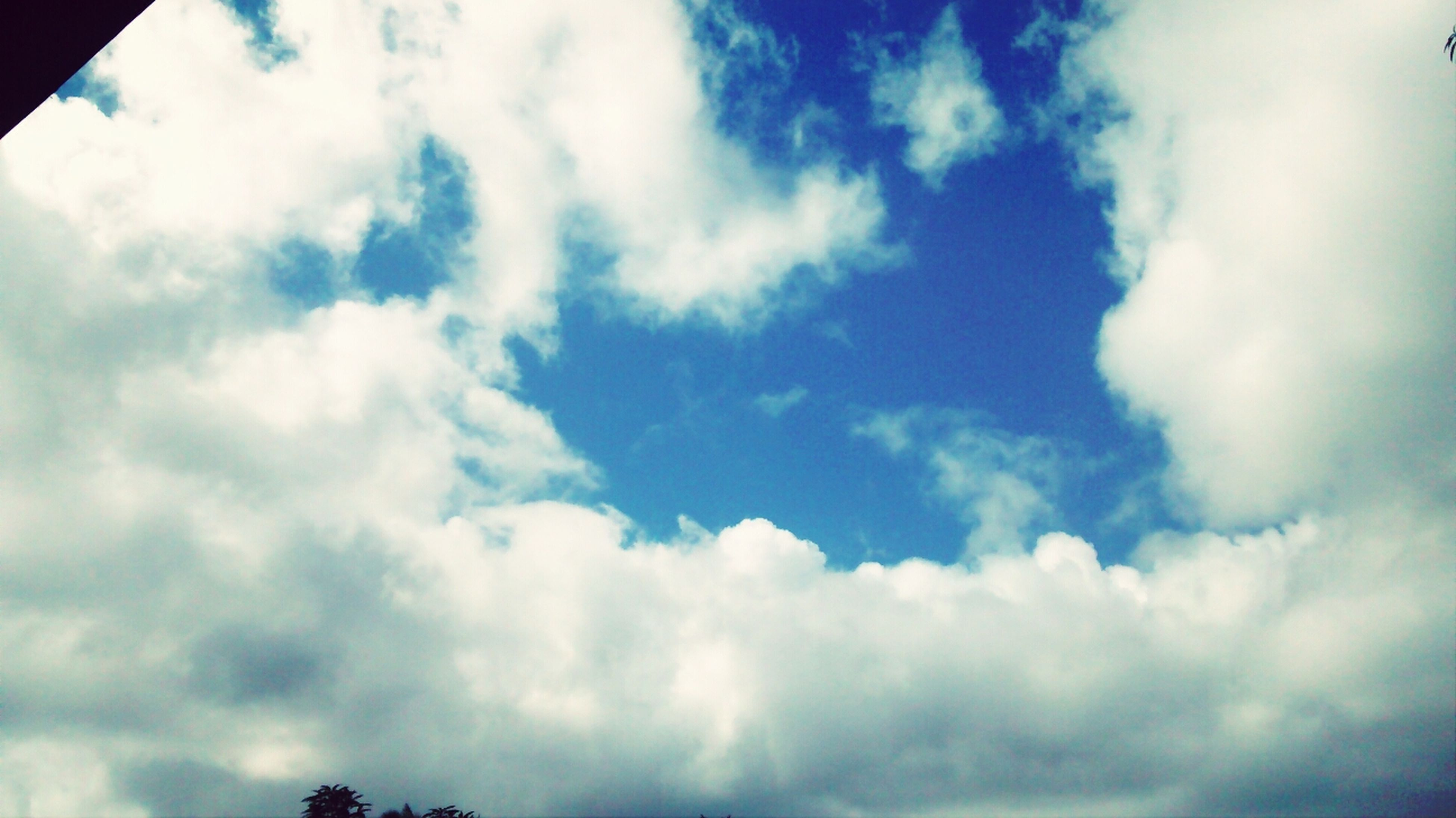 sky, low angle view, cloud - sky, cloudy, sky only, beauty in nature, blue, tranquility, cloud, cloudscape, scenics, nature, tranquil scene, white color, backgrounds, idyllic, day, outdoors, no people, weather