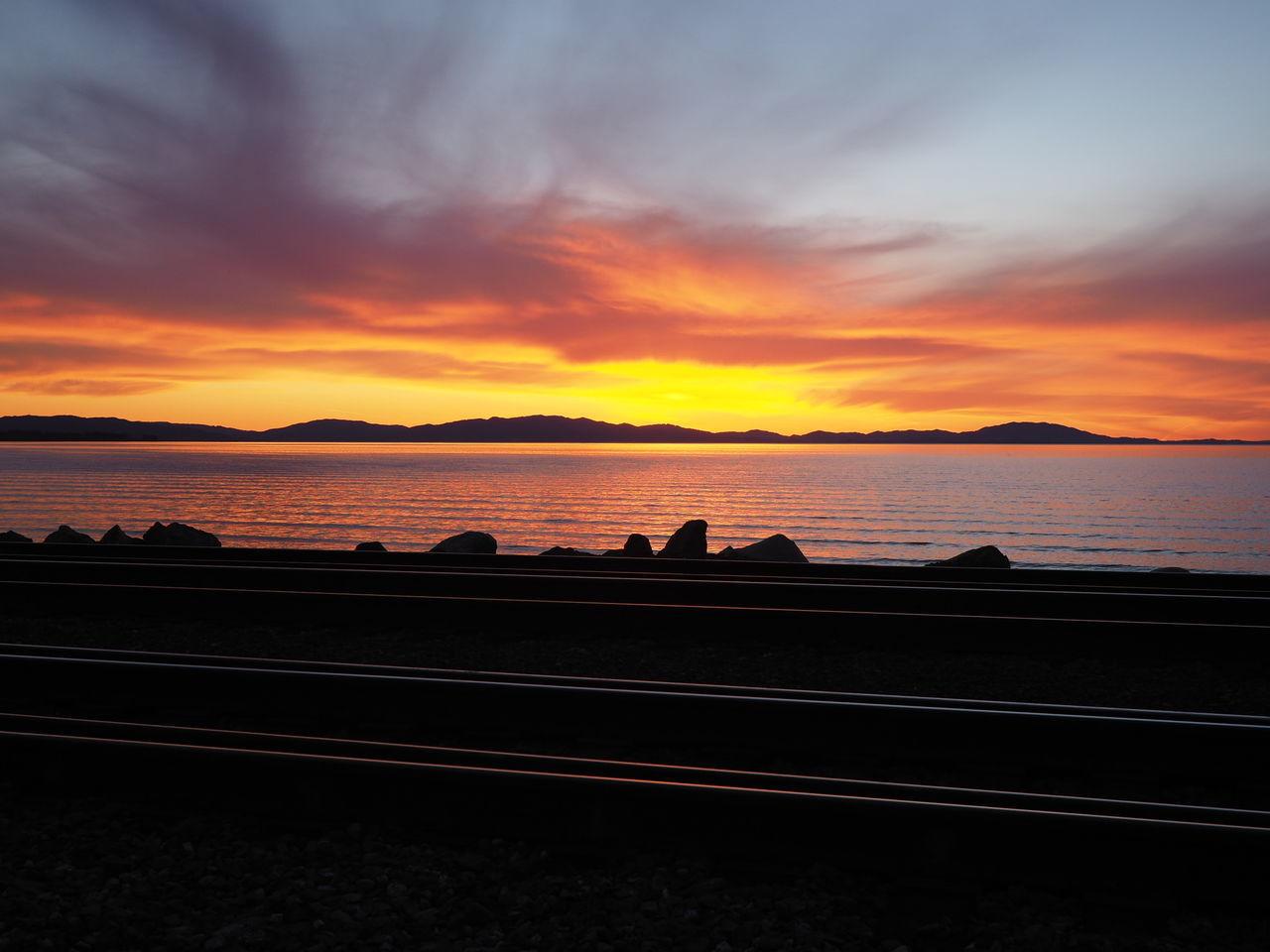 Sunset Sunset_collection Sunset Silhouettes Sunsetbythesea🌅 Twilight Sky Train Tracks Railway Amtrak Landscape Landscape_Collection Taking Pictures Idyllic Scenery 43 Golden Moments