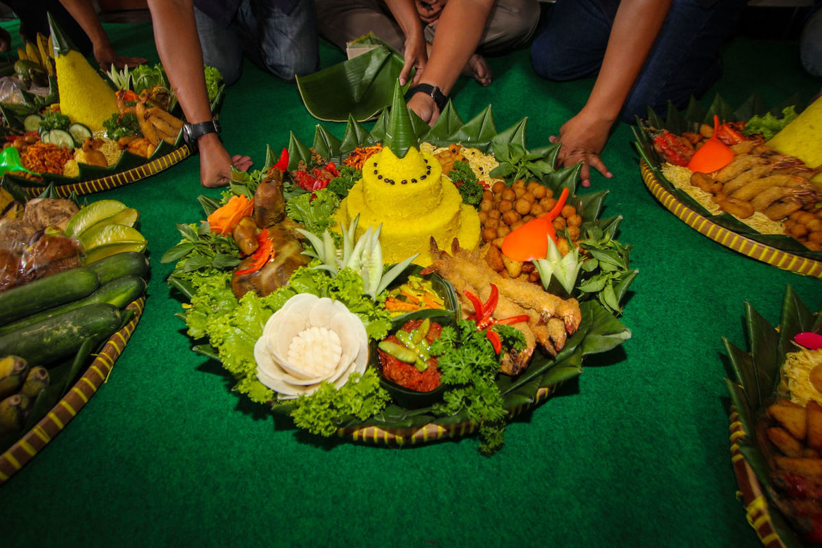 Tumpeng (Cone-shaped rice dish) is a traditional thanksgiving meal with vegetables, crackers and meat in Indonesia. Tumpeng is cooked rice prepared into balls and cones, which will be incorporated into offerings made to please or appease the gods. Traditional Food And Drink Culture Hello World
